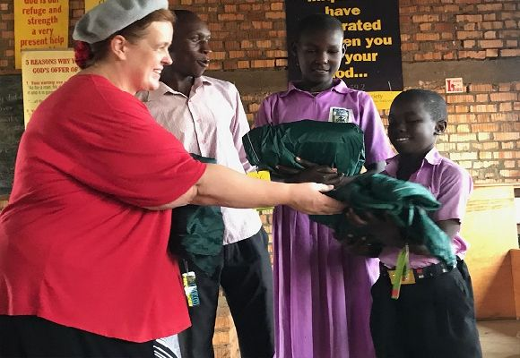 Noreen McAfee distributes the clothes