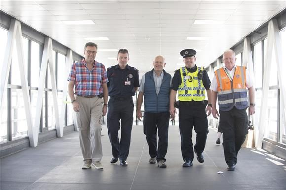 Rev McMillan with Paramedics at Dublin Airport